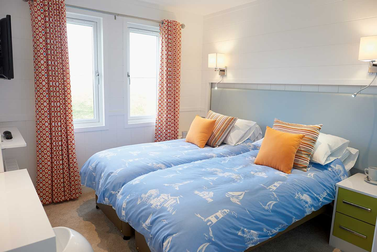 A Beach House twin bedroom with blue bed covers