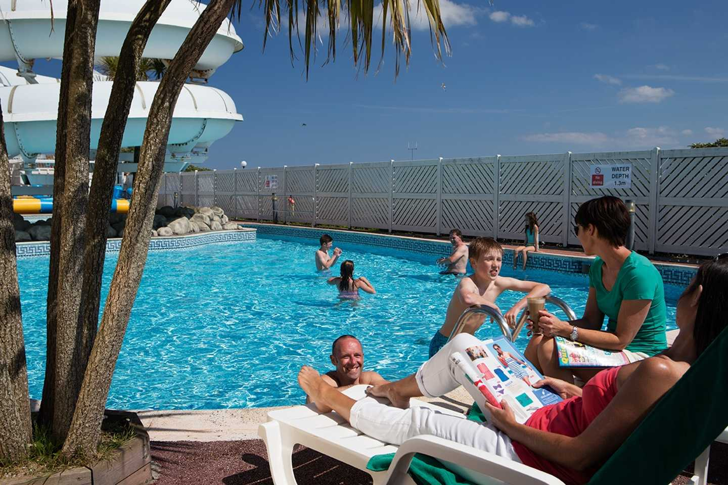 Guests swimming in the heated outdoor pool
