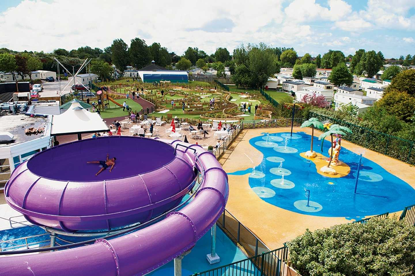 A view of our Space Bowl flume and colourful outdoor SplashZone along with our mini golf course
