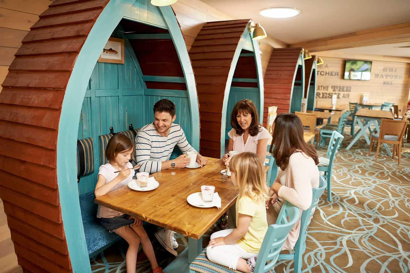 Family eating a meal in the Boathouse bar and restaurant