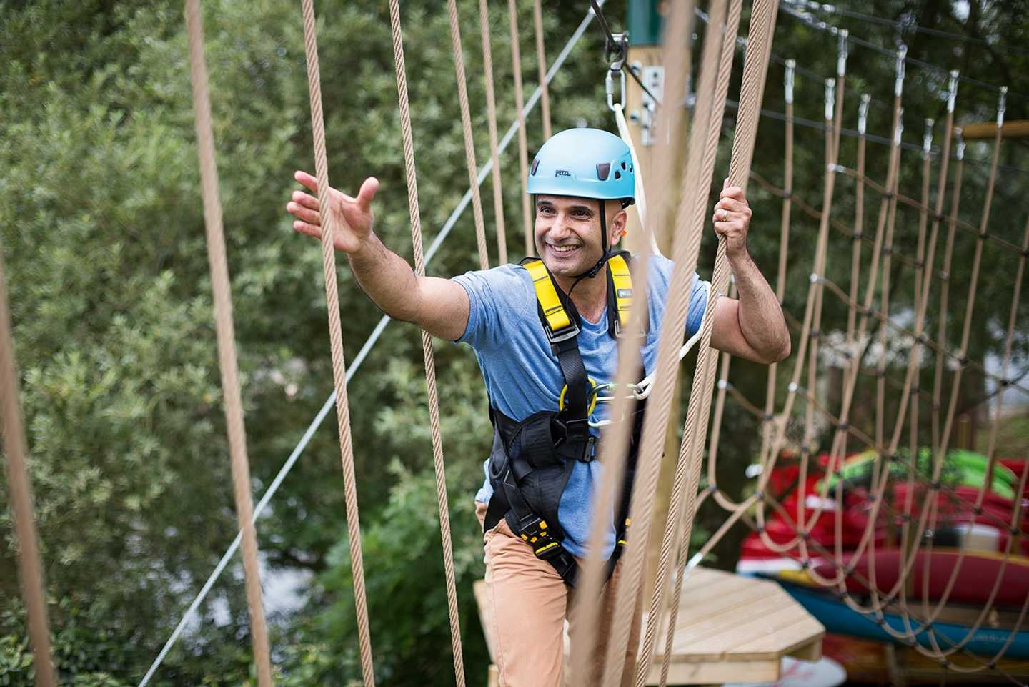 A girl on the Aerial Adventure course