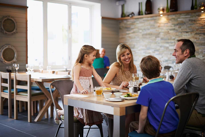 A family eating in the Harbourside restaurant