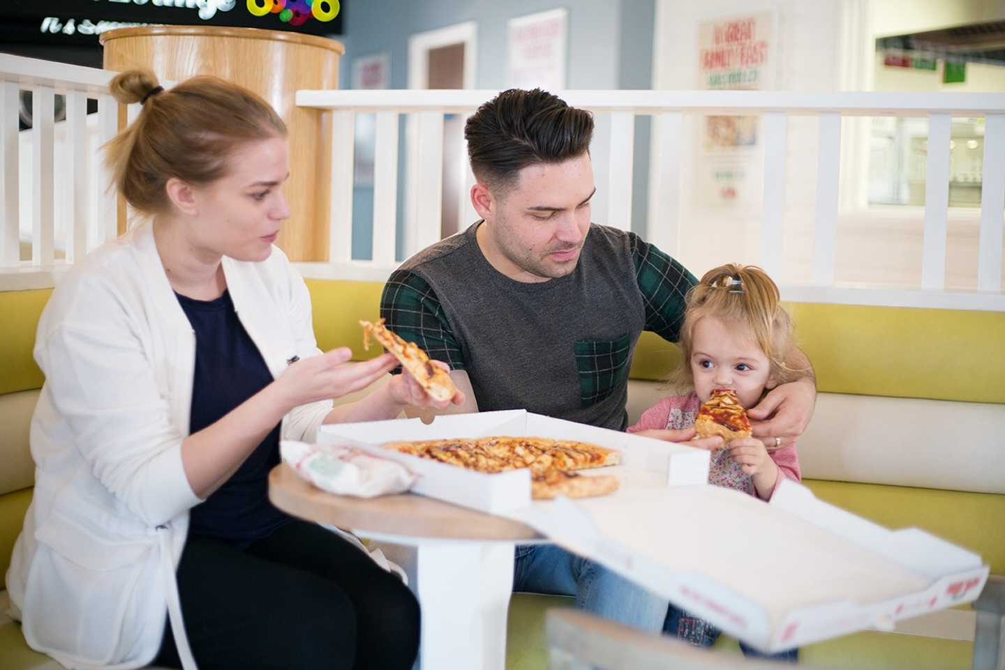 Guests enjoying pizza at Papa John's Pizza