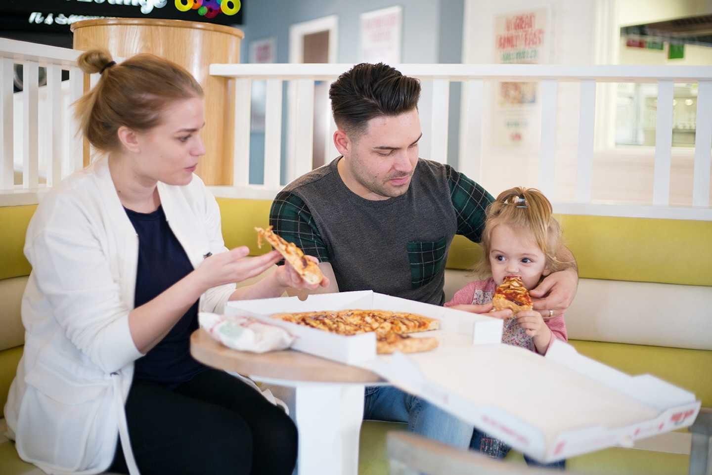 Guests enjoying pizza at Papa John's Pizza