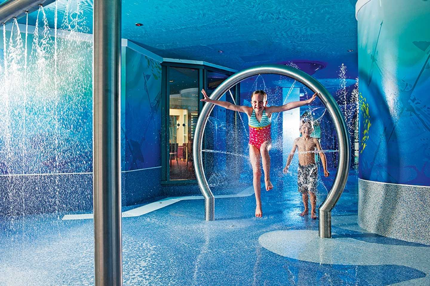 Children playing in the SplashZone grotto