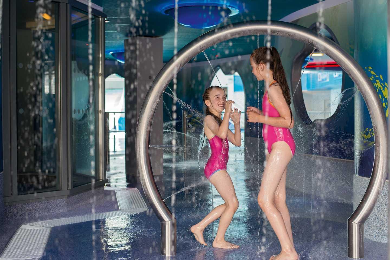 Children playing in the SplashZone grotto