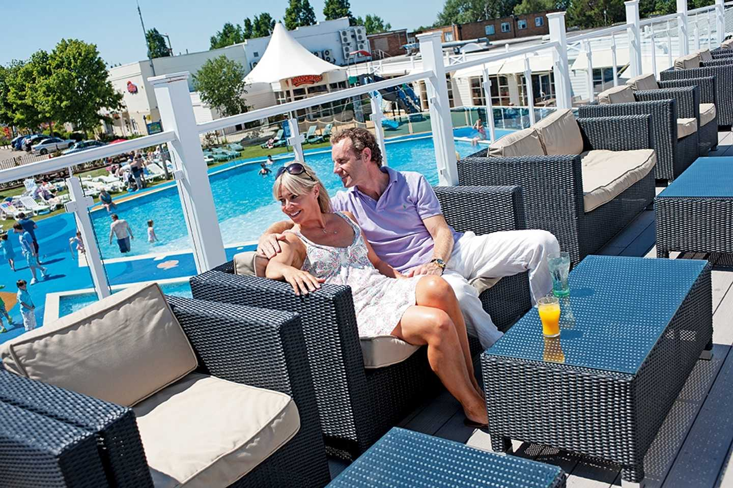 Guests enjoying a drink on the Mash and Barrel terrace overlooking the outdoor pool