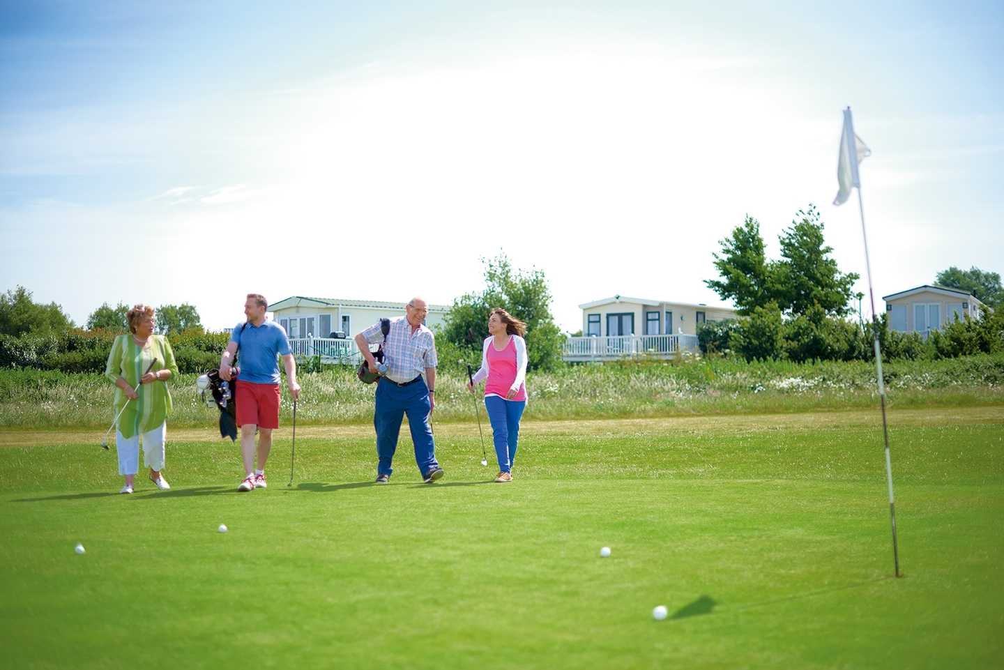 Guests playing a round of golf on the 9-hole golf course at Allhallows