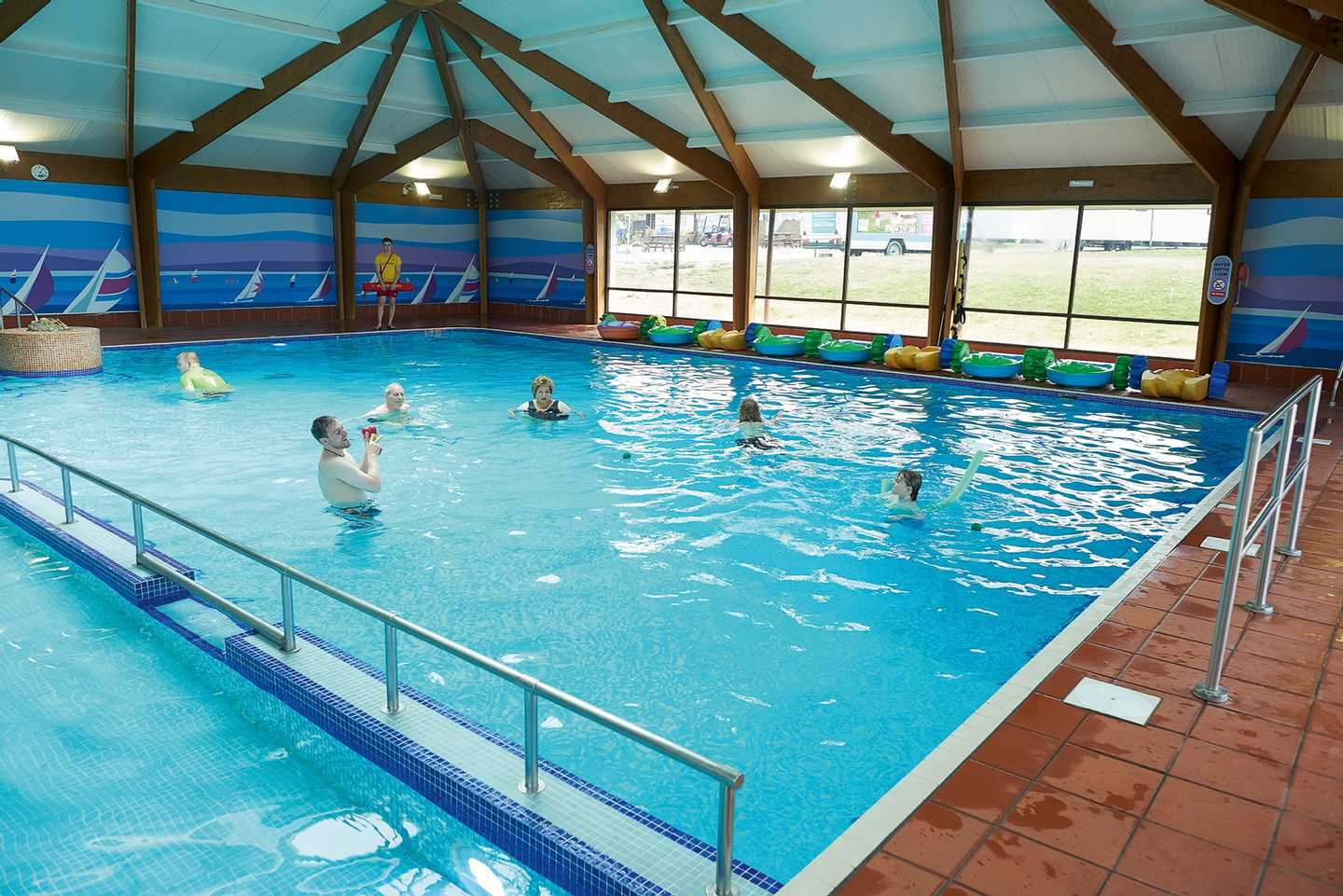 Guests playing in our heated indoor pool