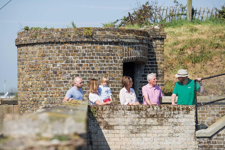 Guests exploring Slough Fort at Allhallows caravan park
