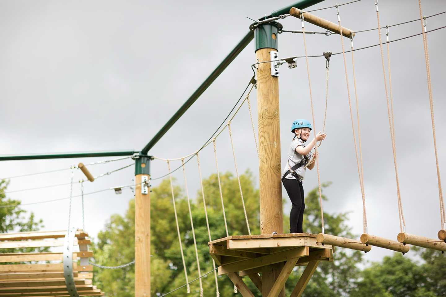 A child taking part in Aerial Adventure