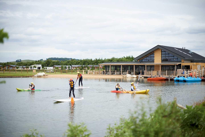 Guests Paddleboarding on the lake at Lakeland