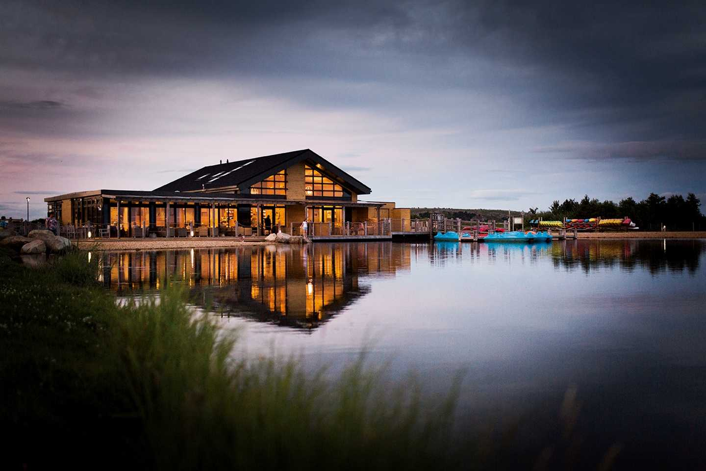 View of Otter Lodge Owners' Lounge from across the lake at Lakeland