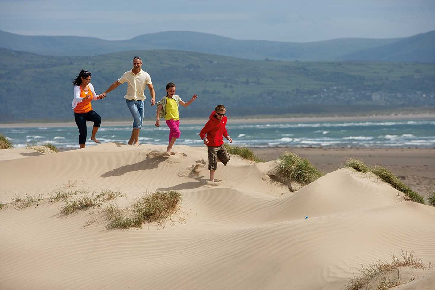 Family walking along the dunes