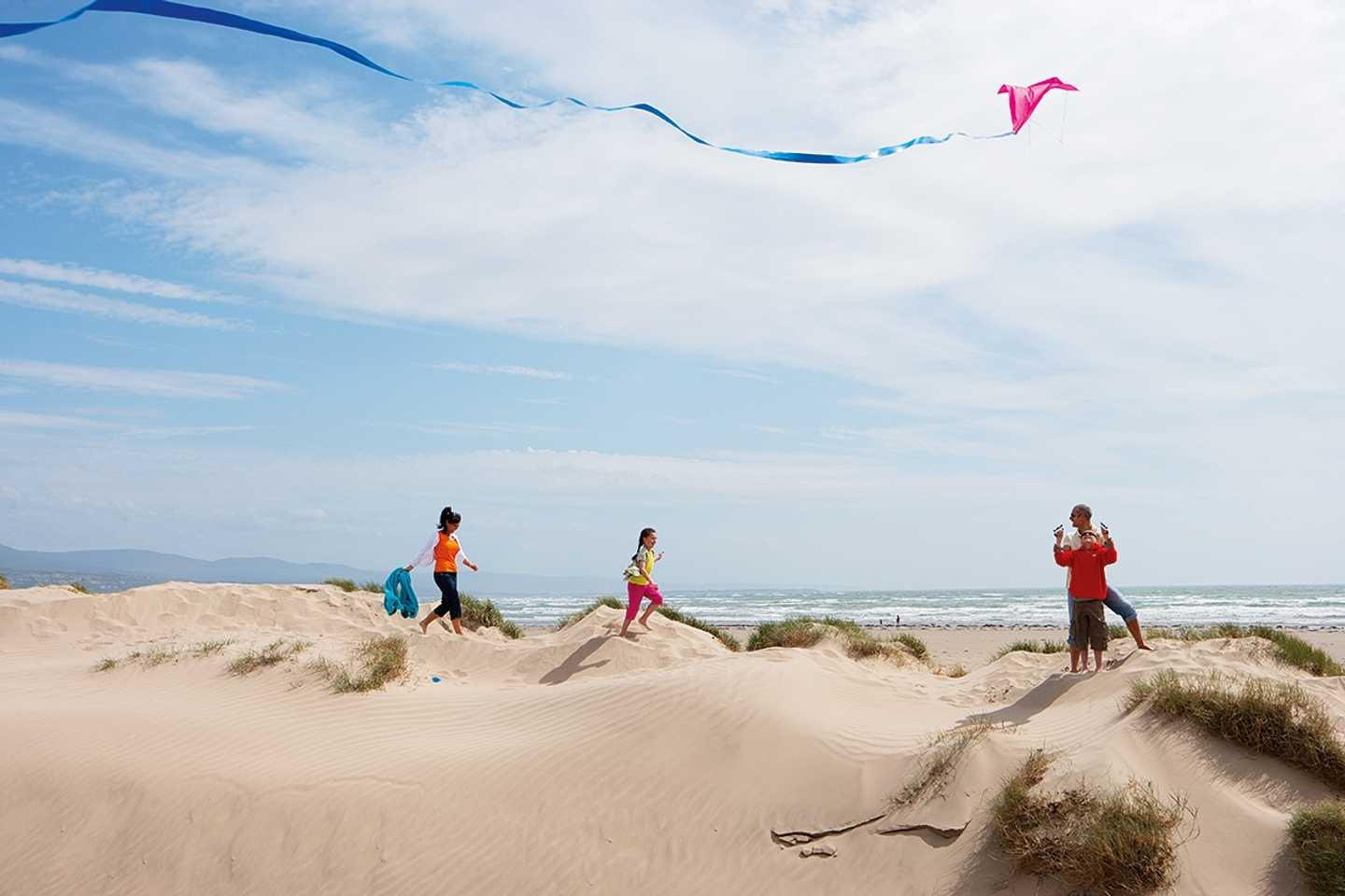 Guests walking along the sand dunes