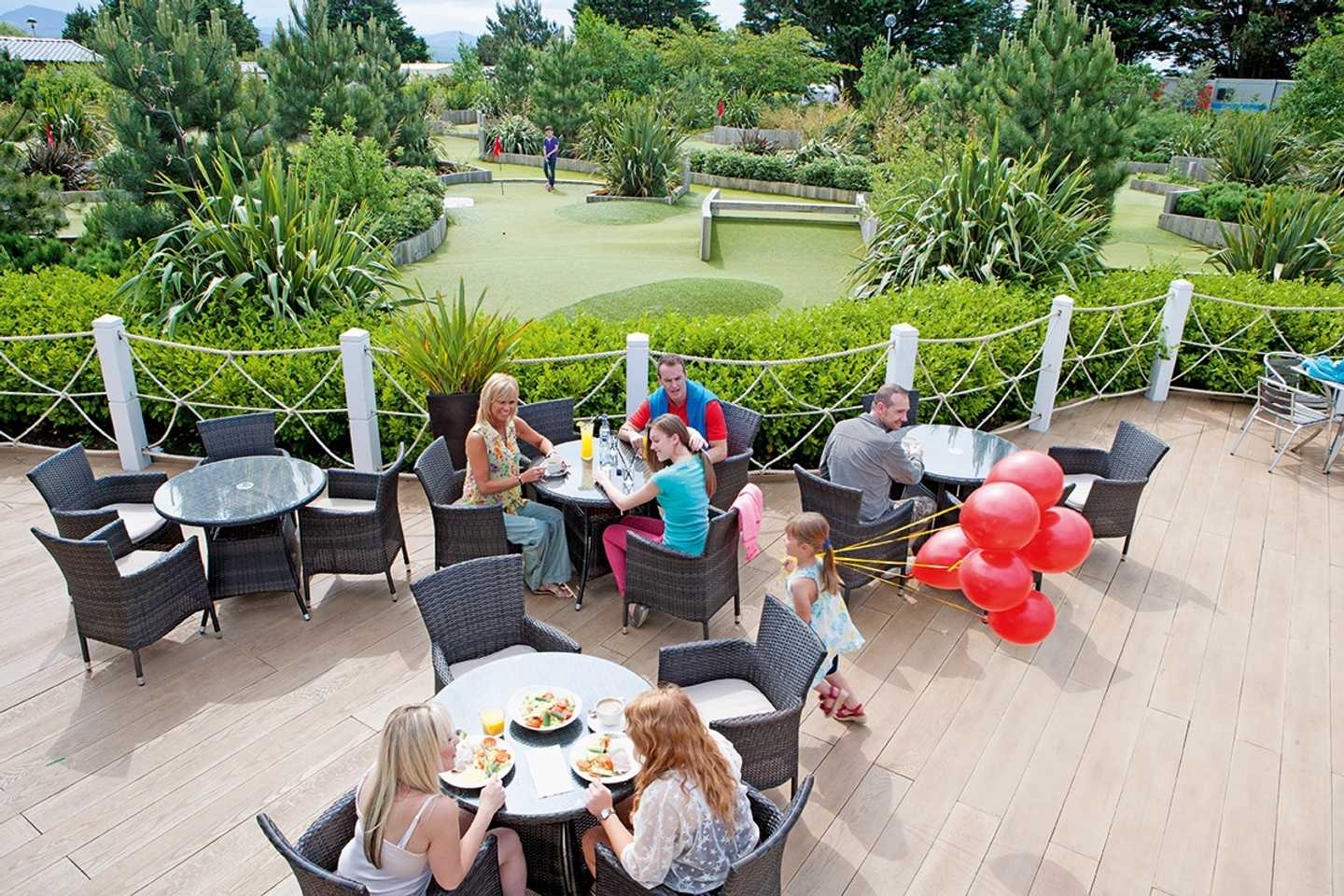 Guests eating on the terrace of the Mash and Barrel restaurant
