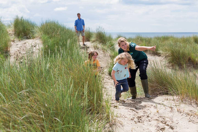 Guests walking towards the beach at Greenacres