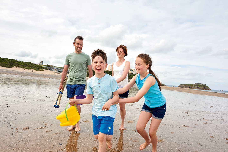 A family on the beach near Kiln Park