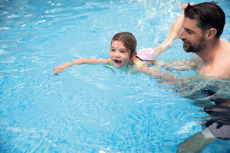 Learn to swim class girl swimming