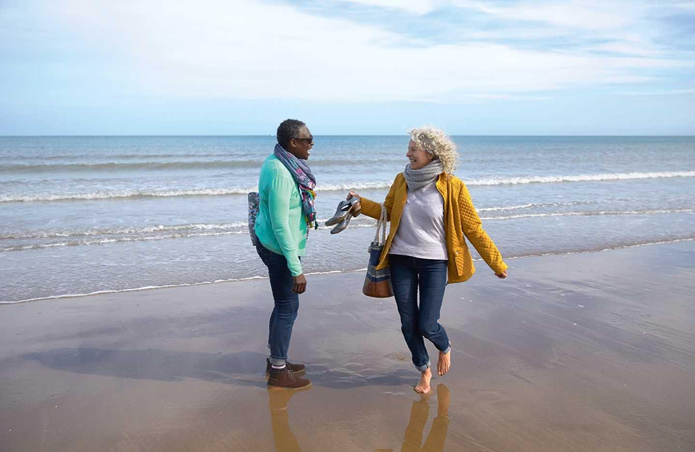 A couple walking a long the beach