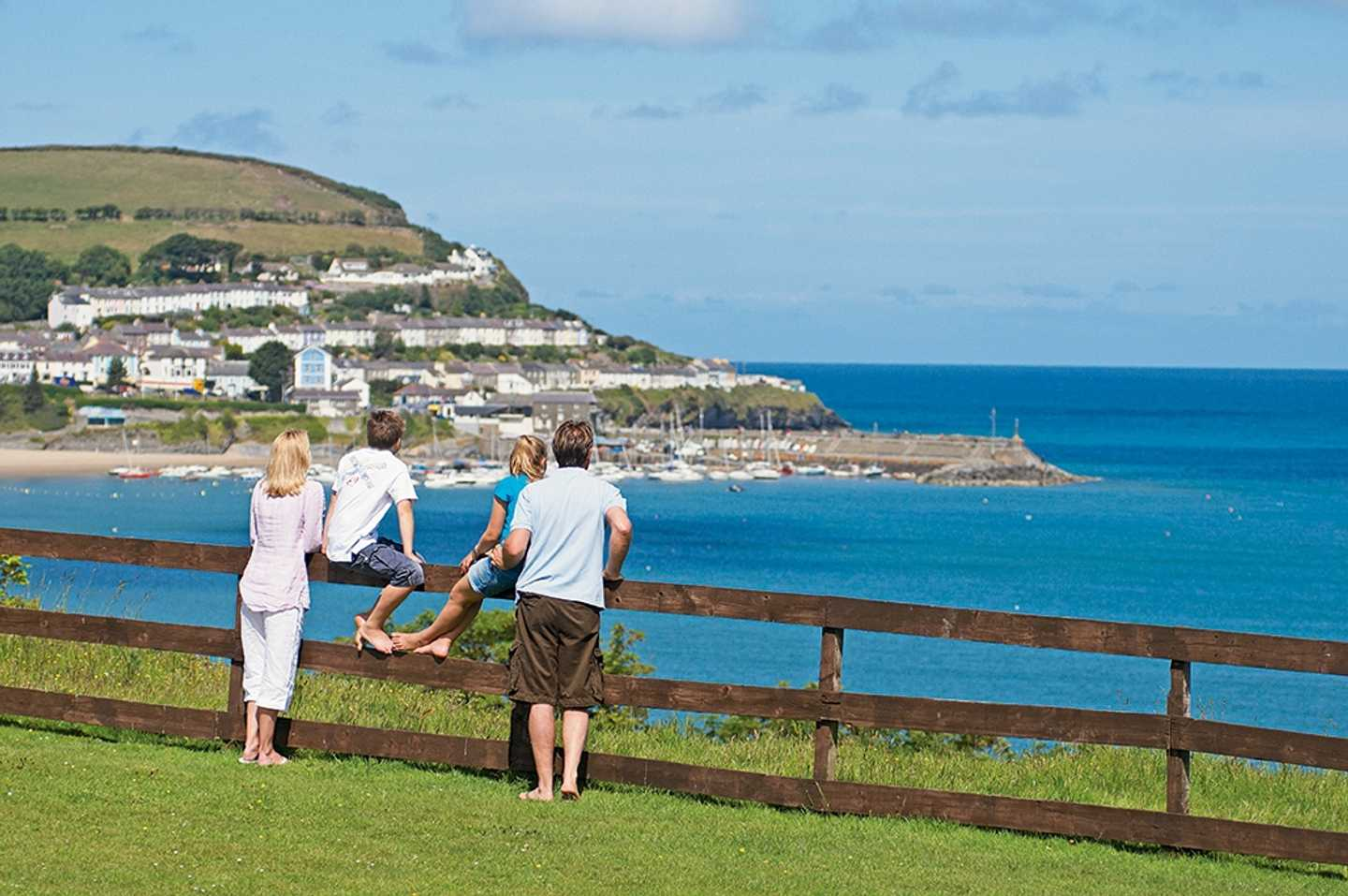 A family admiring the seaview at Quay West
