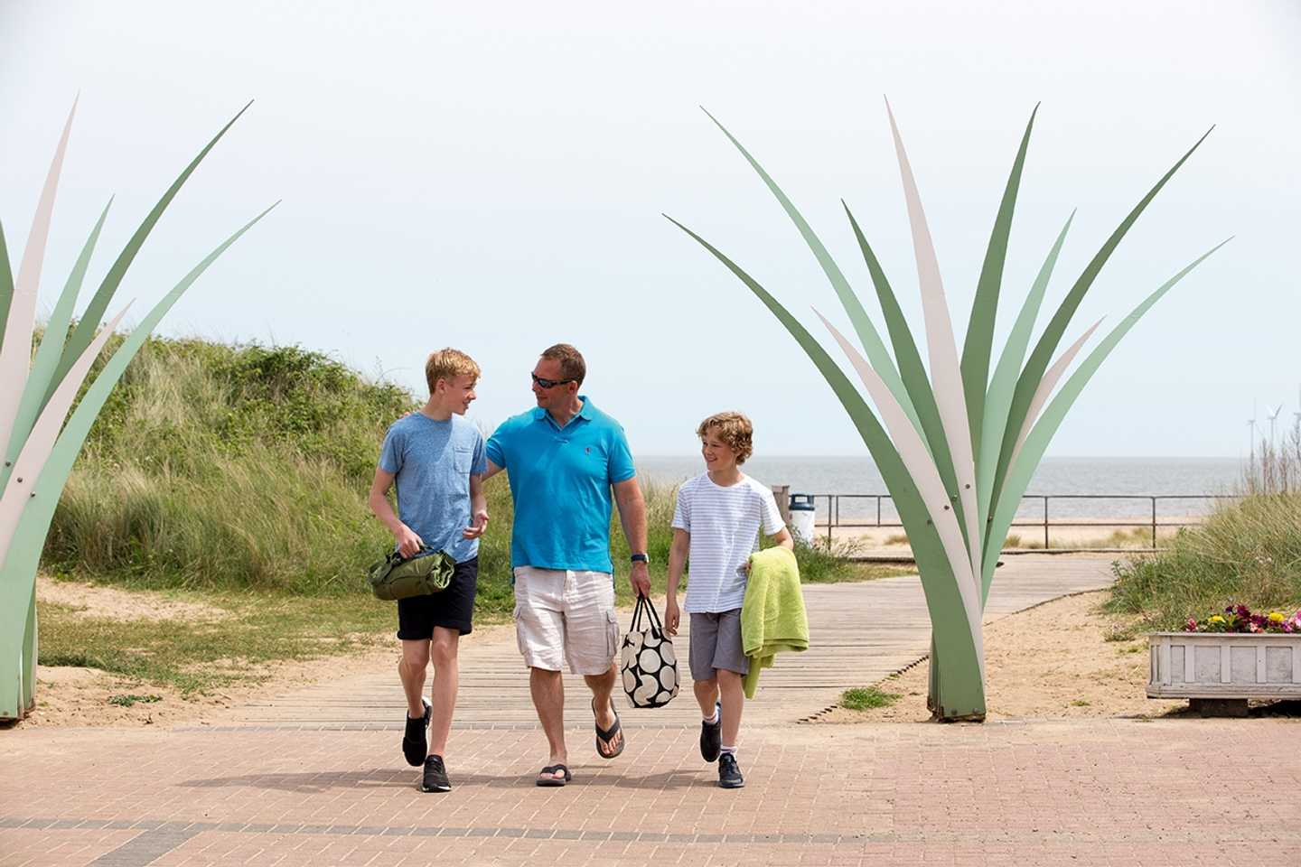 Family coming home from the beach via our direct access walkway