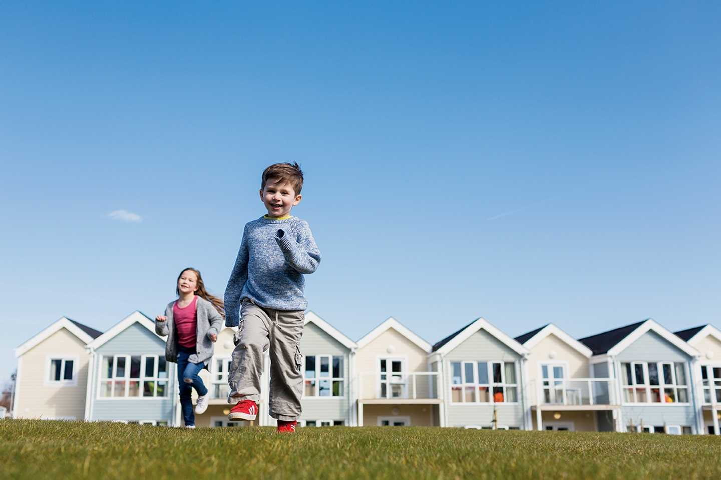 Children playing outside the stylish deck houses