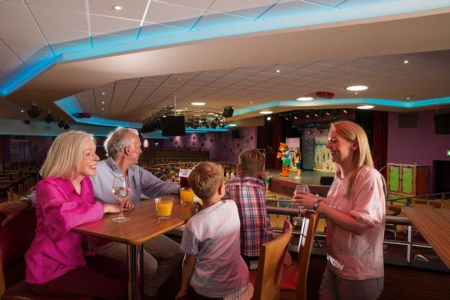 Family enjoying the entertainment in our ShowBar