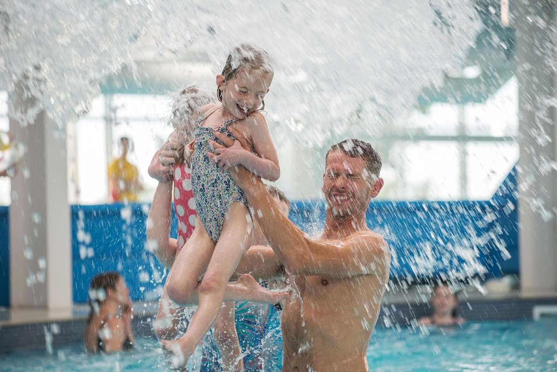 Guests enjoying the heated indoor pool