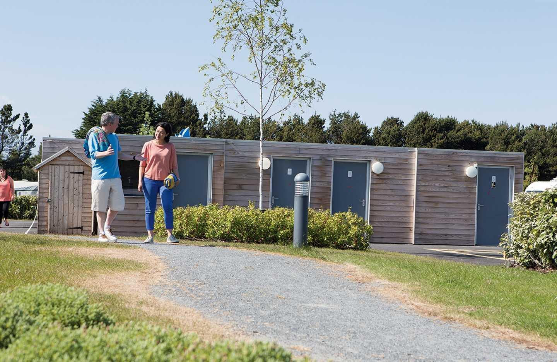 Couple outside touring facilities at Seton Sands, Scotland