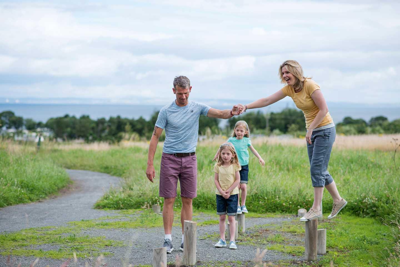 Family doing the adventure trail at Seton Sands, Scotland