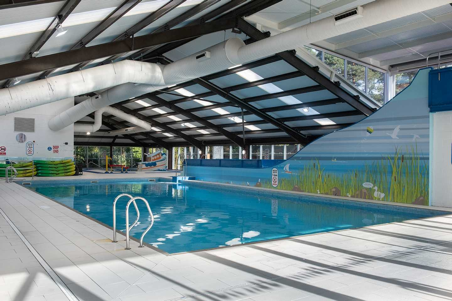Guests swimming in the indoor pool