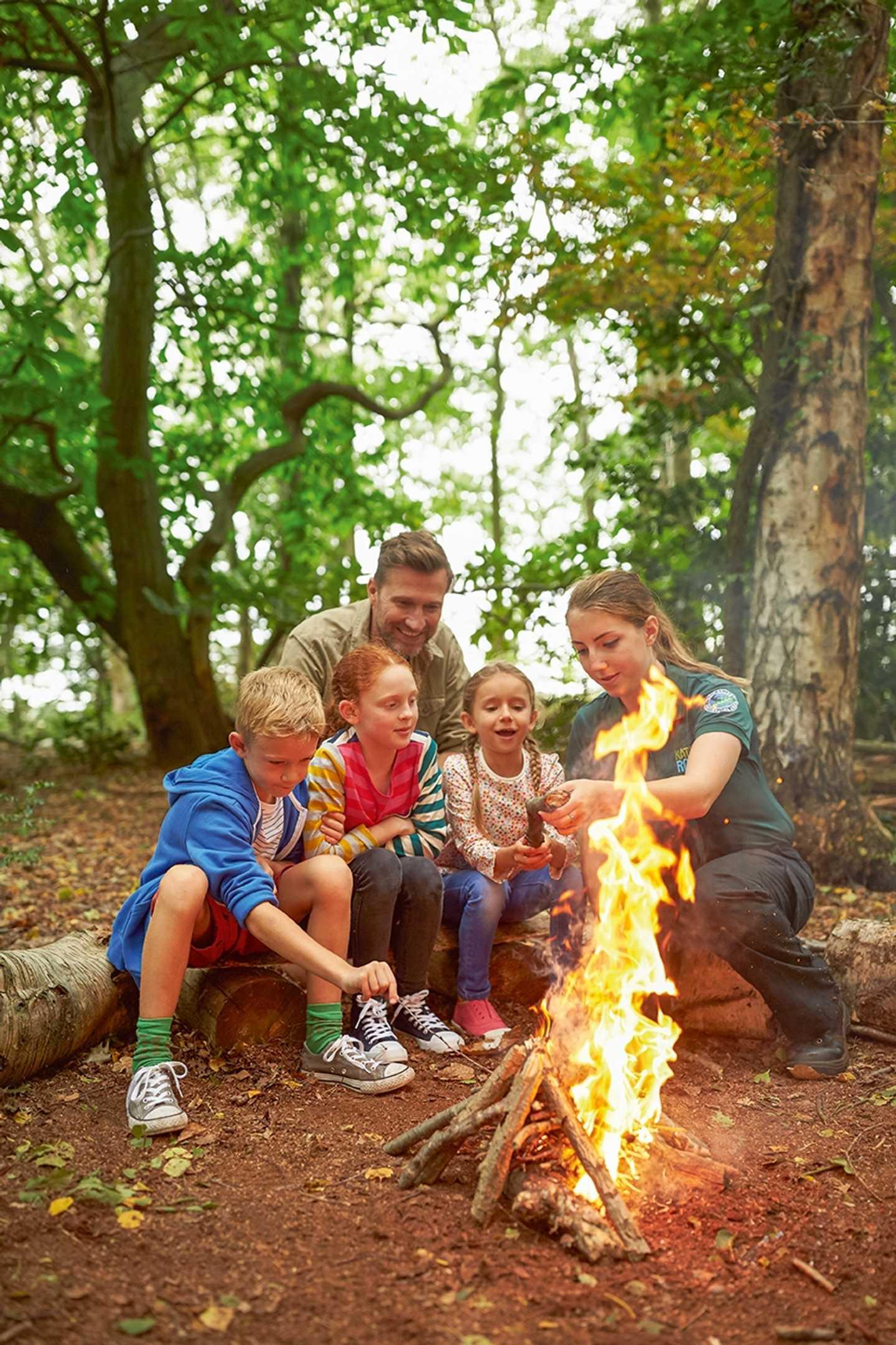 Kids and ranger firelighting