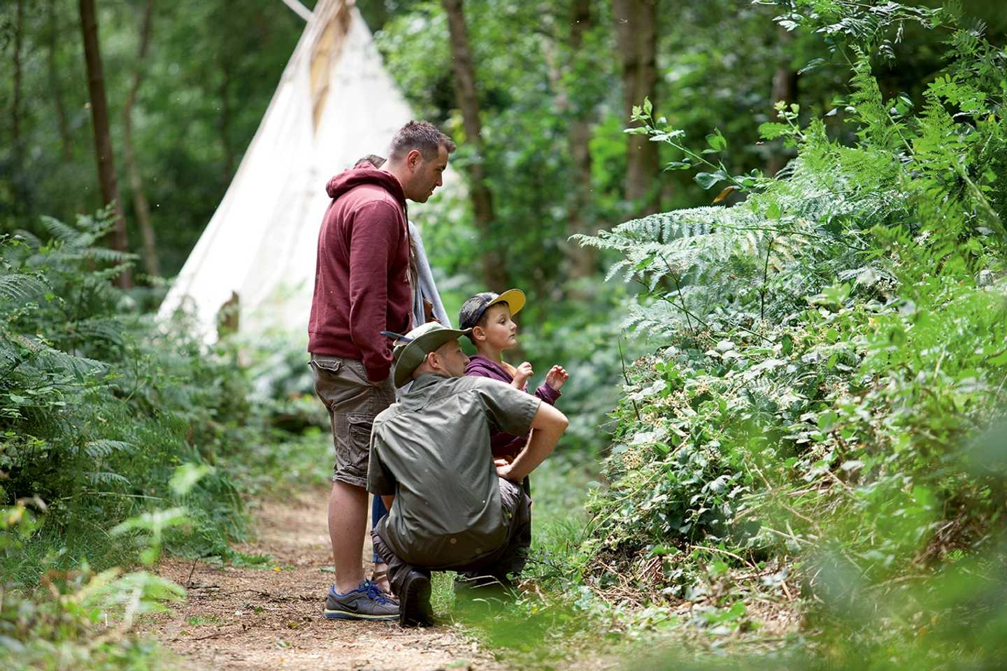 Guests doing Nature Rockz activities in the woodland at Wild Duck