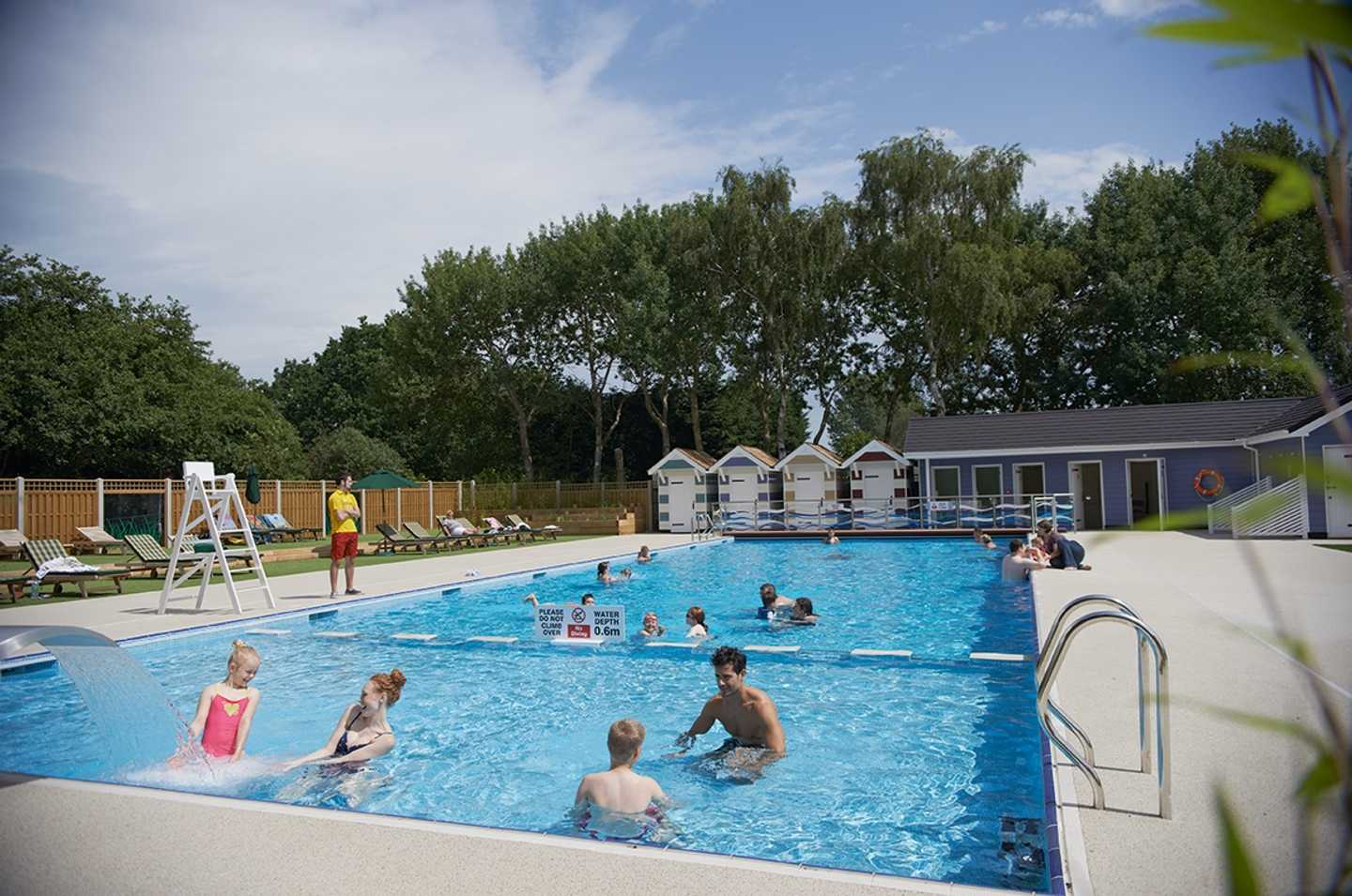 Guests playing in the outdoor pool