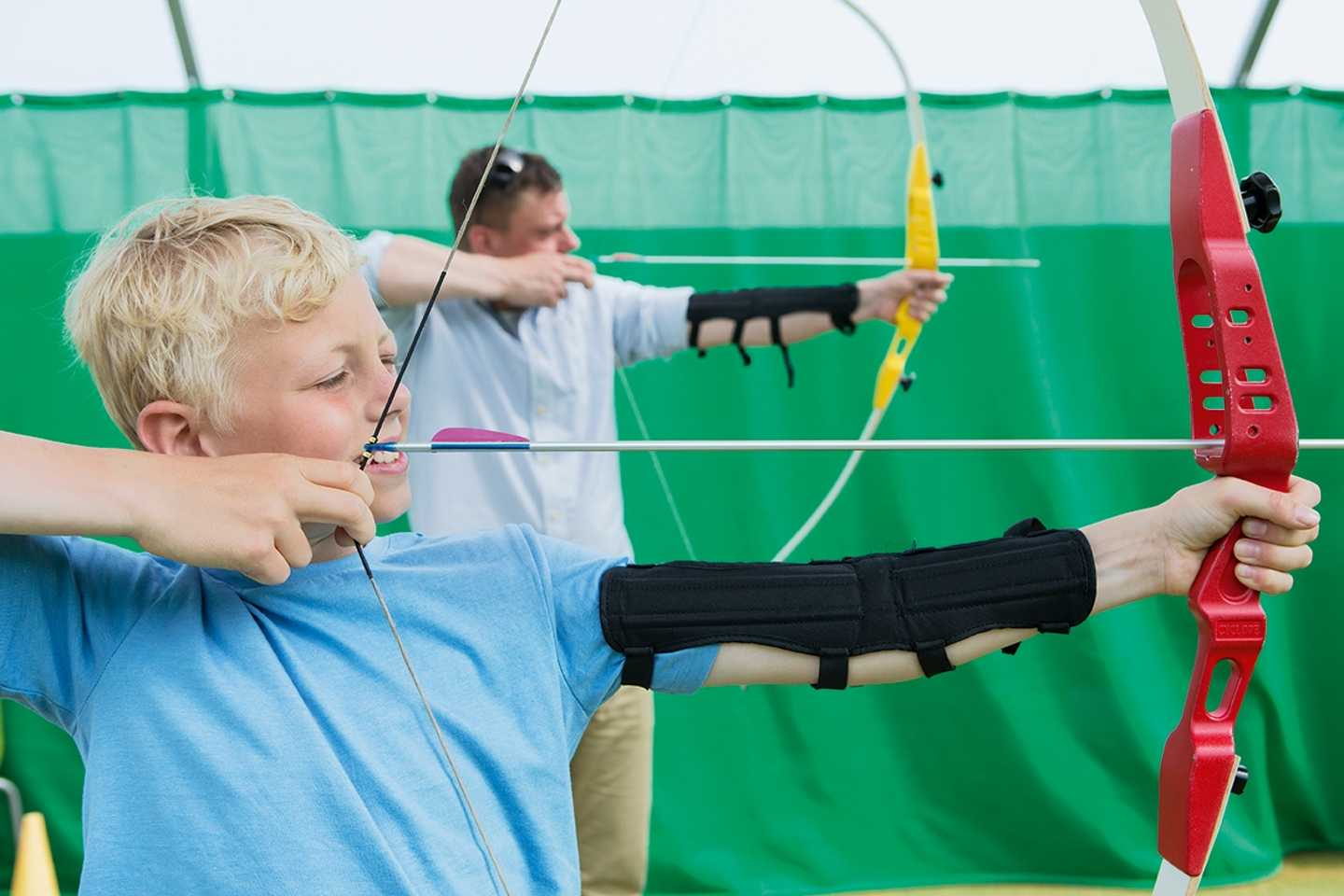 Children trying out archery