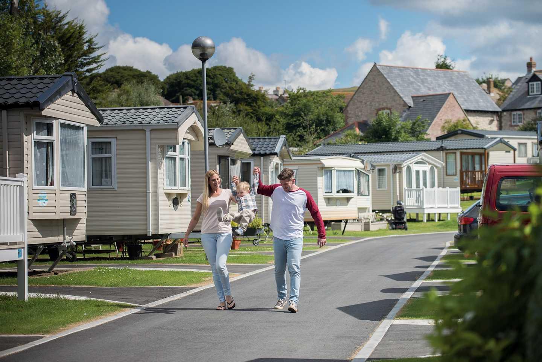 Guests walking through Weymouth Bay