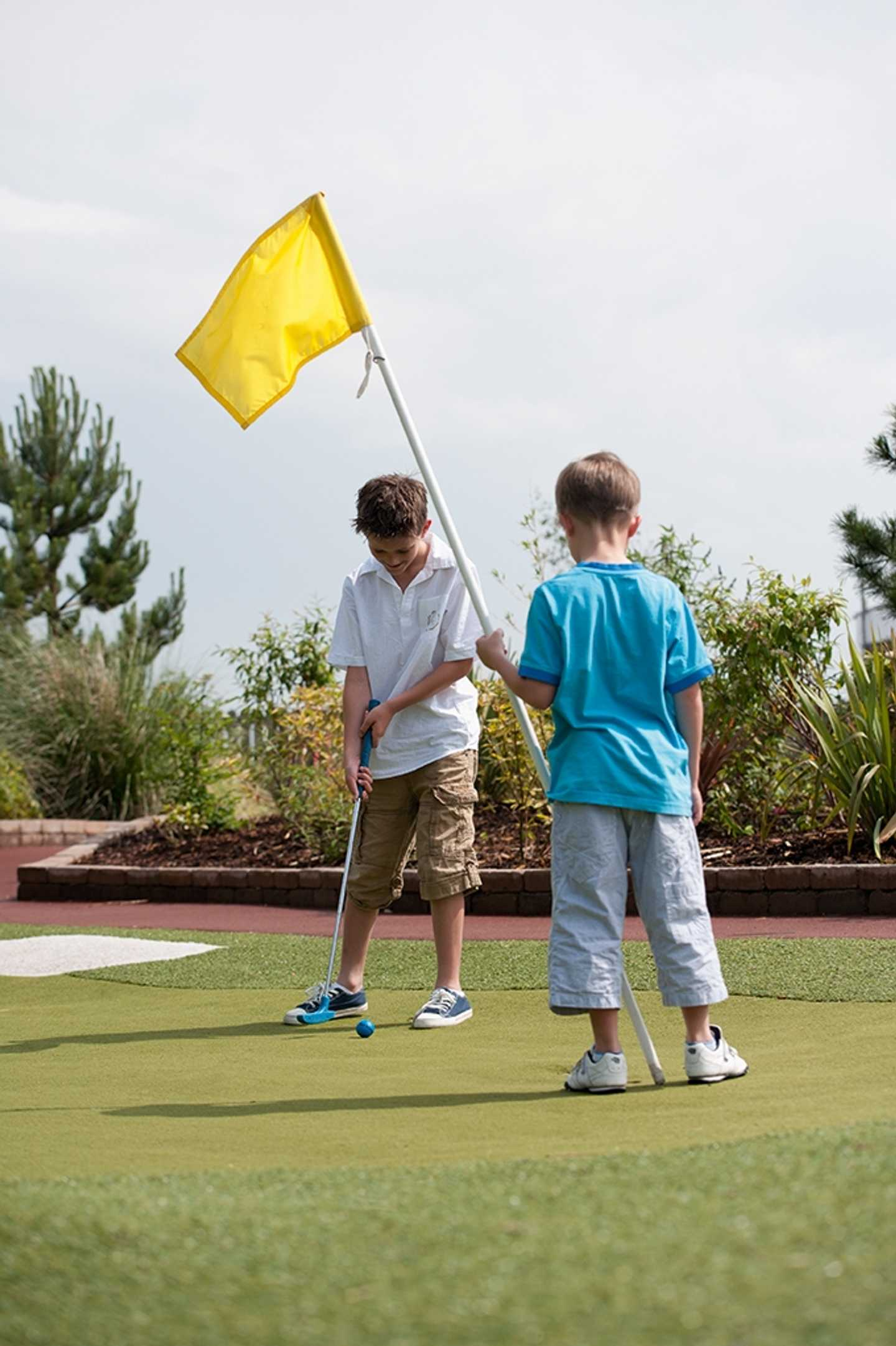 Guests playing Adventure Golf