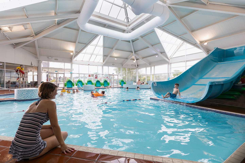 Families splashing around in the heated indoor pool
