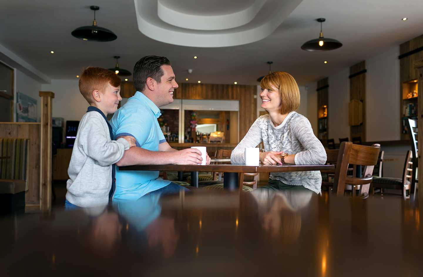 Family relaxing in the owners lounge at Cala Gran