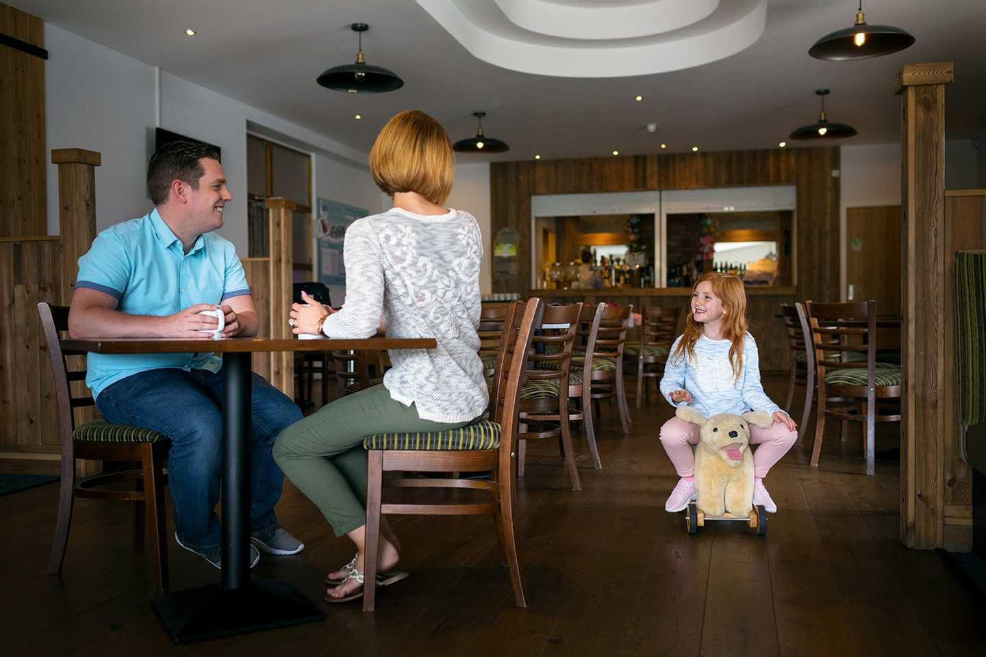 A family in the Owners' Lounge