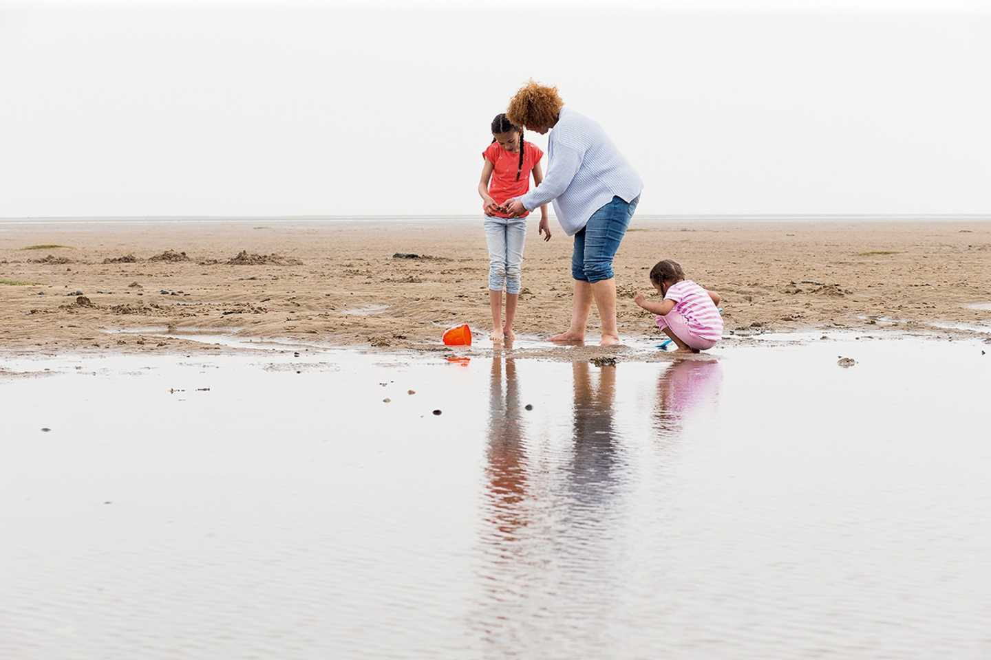 Family on the beach at Presthaven