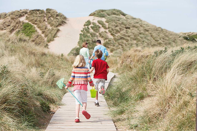 Family running along the boardwalk