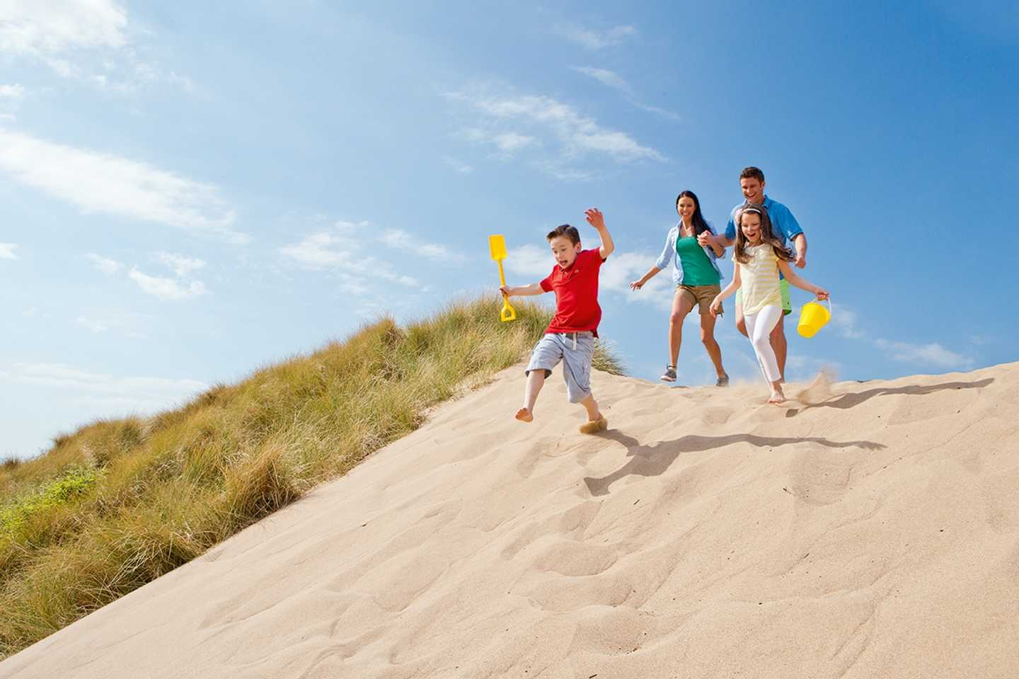 Guests running over the sand dunes
