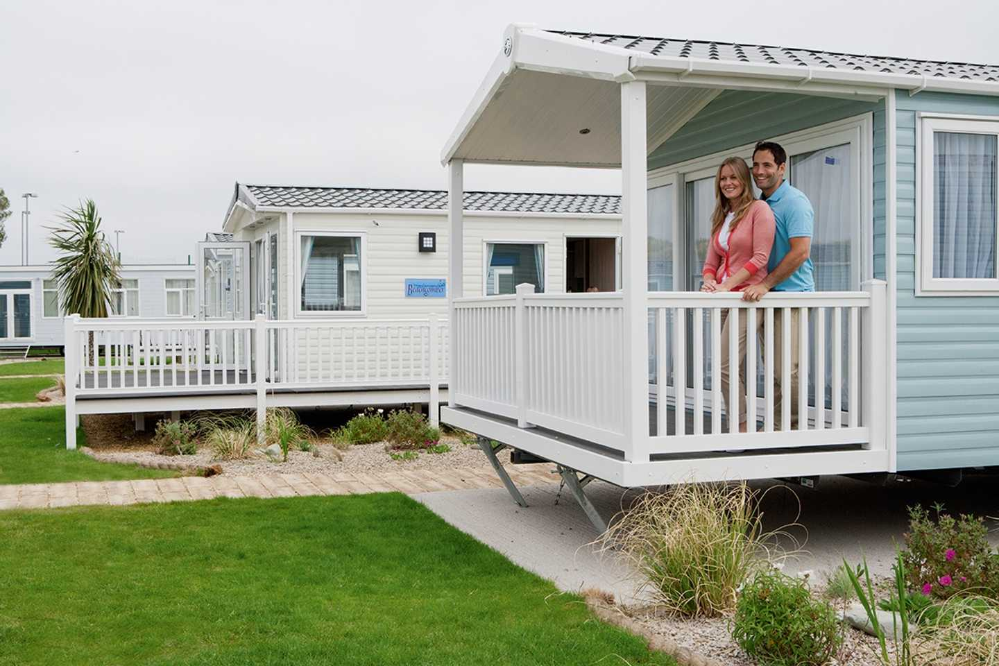 Owner standing on their veranda of their holiday home at Presthaven