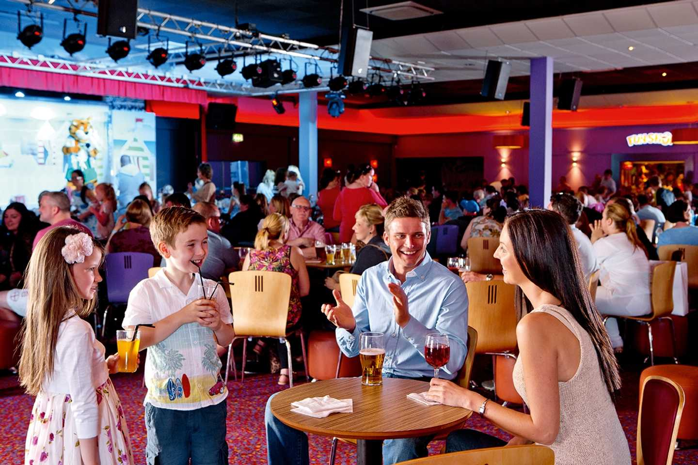 A family clapping at the evening entertainment at our ShowBar