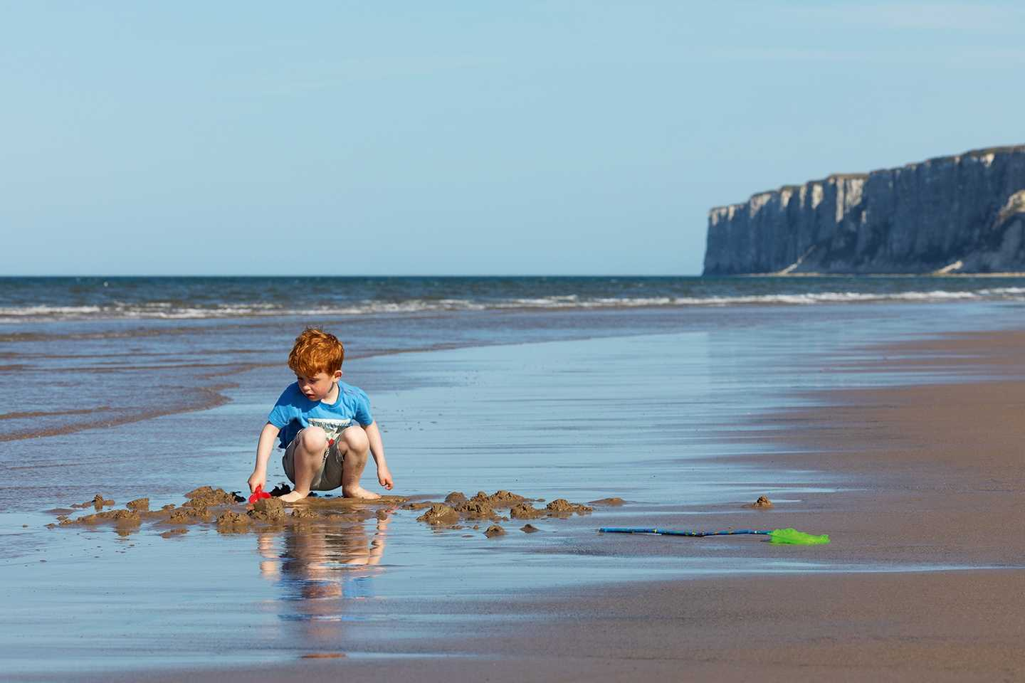 Child on the beach at Reighton Sands