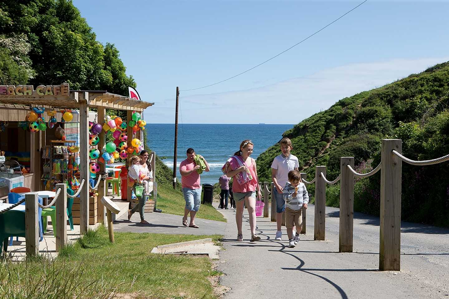 Guests buying ice-creams and bucket and spades at the Beach Cafe