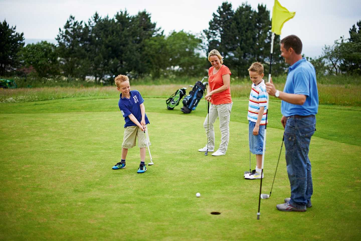 Family playing on the 9-hole golf course at Reighton Sands