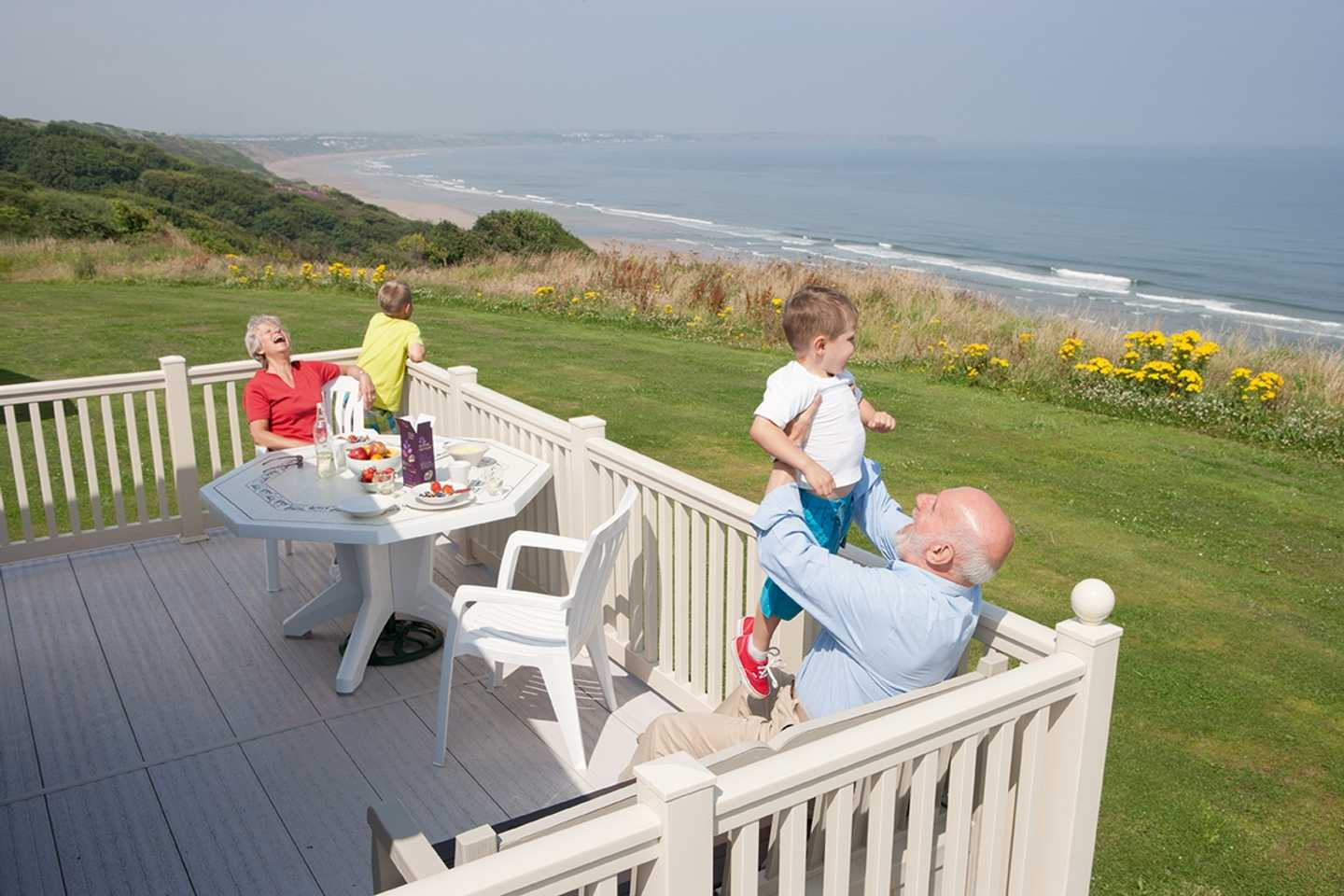 Owners on the veranda of their holiday home at Reighton Sands